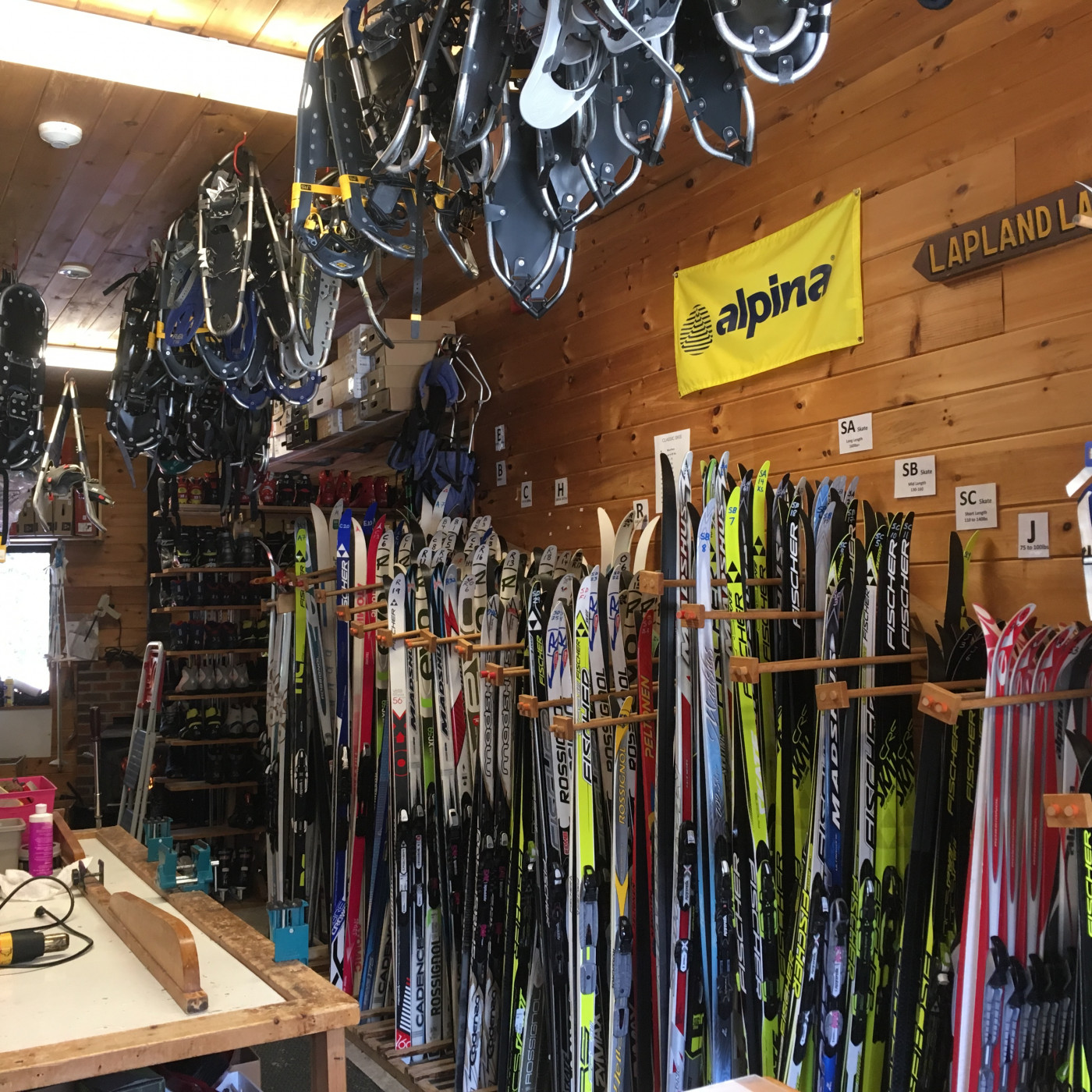 Cross country skis & snowshoes ready for customers in the rental shop